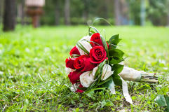 Wedding bouquet of the bride. With red and white roses Stock Image