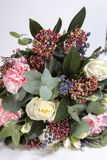 The Wedding bouquet of a bride from a rose, a pink carnation, eucalyptus on a wooden table Royalty Free Stock Images