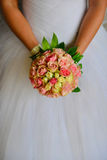 Wedding bouquet in bride's arms Royalty Free Stock Image
