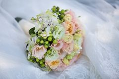 Wedding Bouquet on Bride's Dress. Still Life of Bride's Pink Orange and White Bouquet Outdoor Royalty Free Stock Photos