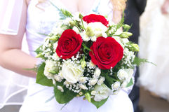 Wedding bouquet at bride's hands Stock Images