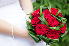 Wedding bouquet of bride's hands Royalty Free Stock Images