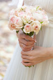 Wedding bouquet at bride's hands. This is wedding bouquet at bride's hands Stock Photo