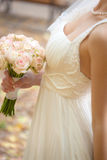 Wedding bouquet at bride's hands Stock Photography