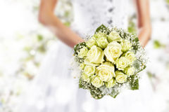 Wedding bouquet at bride's hands. On park background Stock Photos