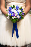 Wedding bouquet at bride's hands Royalty Free Stock Images