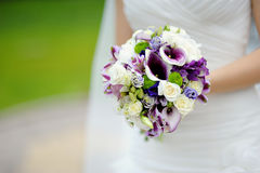 Wedding bouquet at bride's hands Royalty Free Stock Photography