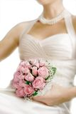 Wedding bouquet in bride's hands. Focus on flowers Royalty Free Stock Photography
