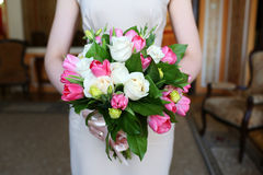 Wedding bouquet in bride's hands Stock Photography