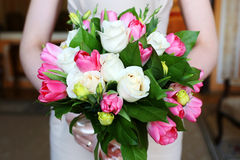 Wedding bouquet in bride's hands Royalty Free Stock Images
