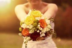 Wedding bouquet in the bride's hands Stock Images