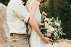 Wedding bouquet in bride`s hands. Royalty Free Stock Photography