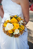 Wedding bouquet at bride's hands Royalty Free Stock Photos