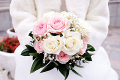 Wedding bouquet in bride's hands Royalty Free Stock Image
