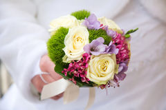 Wedding bouquet in bride's hands Royalty Free Stock Photos