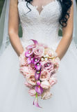 Wedding bouquet in bride`s hands Royalty Free Stock Photography