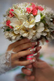 Wedding bouquet in the bride's hands Stock Images