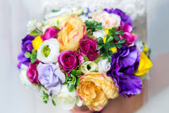 Wedding bouquet in bride`s hands Royalty Free Stock Photos