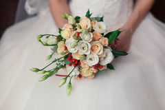 Wedding bouquet in bride`s hands Stock Images