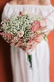 Wedding bouquet in bride's hands closeup Stock Photography
