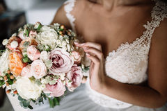 Wedding bouquet in bride`s hands, david austin Stock Photo