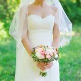 Wedding bouquet in bride's hands Royalty Free Stock Image