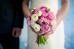 Wedding bouquet in the bride's hands. Wedding bouquet flowers with colored flowers Royalty Free Stock Photography