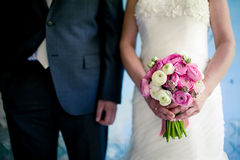 Wedding bouquet in the bride's hands Royalty Free Stock Photos