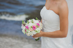 Wedding bouquet in the bride's hands Stock Photos