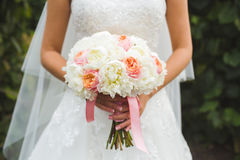 Wedding bouquet in the bride's hands Stock Photography