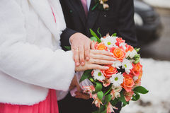 Wedding bouquet in the bride's hands. Wedding bouquet flowers with colored flowers Royalty Free Stock Images