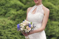 Wedding bouquet in bride's hands Royalty Free Stock Photography