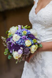 Wedding bouquet at bride's hands Stock Photo