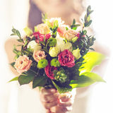 Wedding bouquet in bride's hands Stock Photo