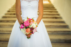 Wedding bouquet in bride`s hands Stock Photos
