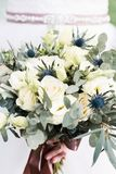 Wedding bouquet in bride`s hands close-up Royalty Free Stock Images
