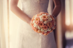 Wedding bouquet at bride's hands. studio shot.  Royalty Free Stock Photography