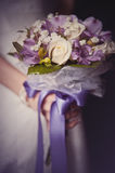Wedding bouquet in bride's hands Stock Images