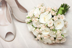 Wedding bouquet and bride's shoes Royalty Free Stock Images