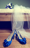 Wedding bouquet and bride's shoes Royalty Free Stock Photo