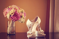 Wedding bouquet and bride's shoes Royalty Free Stock Image