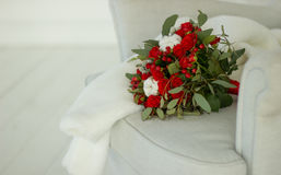 Wedding bouquet. The bride`s  wedding bouquet with white and red roses Stock Images