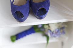 Wedding bouquet and bride shoes Royalty Free Stock Images