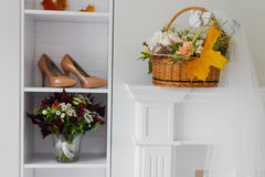 Wedding bouquet and bride shoes Stock Photography