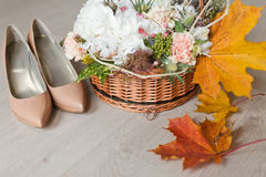 Wedding bouquet and bride shoes Stock Photo
