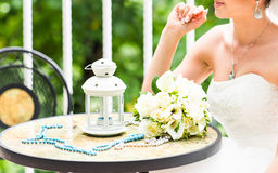 Wedding bouquet of bride - white roses and callas lying on table at wedding. Stock Photography