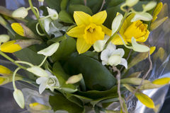 The Wedding bouquet for the bride of yellow daffodils and white orchids Stock Photo