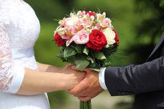 Wedding bouquet in brides and grooms hands Stock Photography