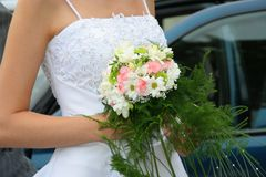 Wedding bouquet in brides hand Stock Images