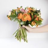 Wedding bouquet of buttercups, anemones and Ruscus Royalty Free Stock Image